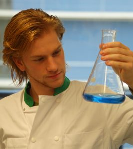 student watches fluid in bottle